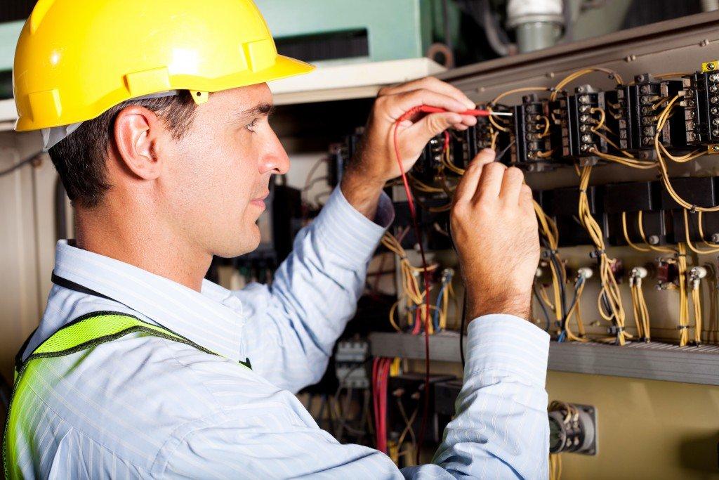 Kelowna electrician - Epic Electric - electrician working on circuit board
