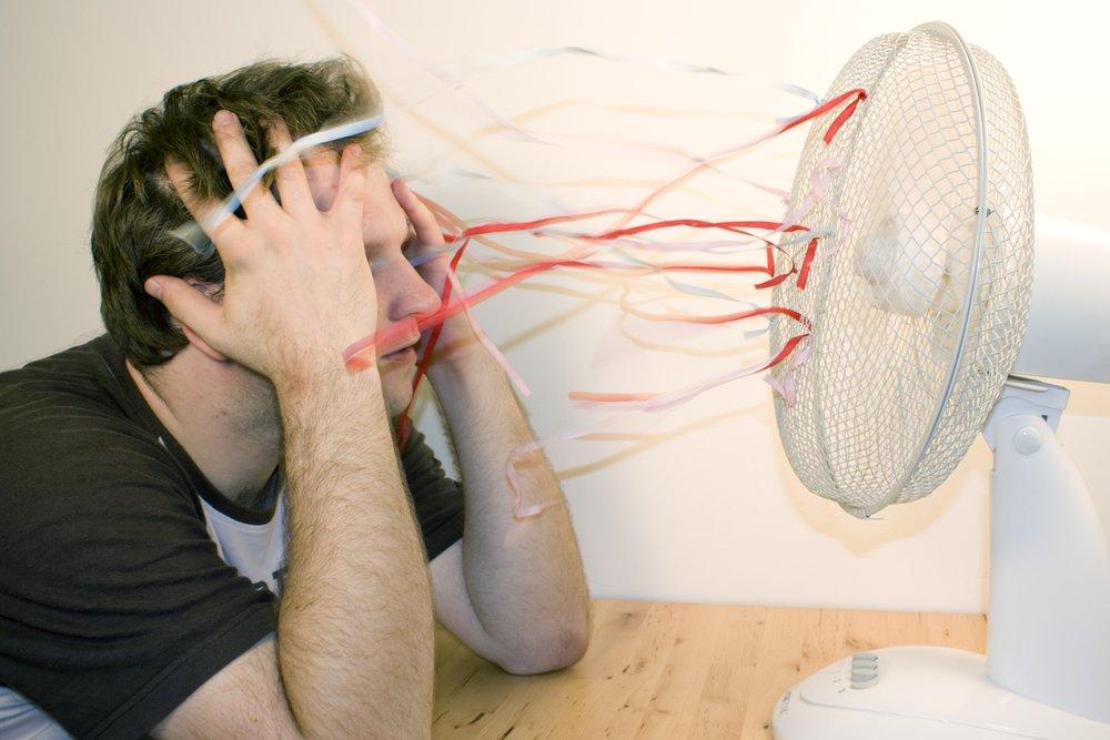 Kelowna Electrician: Epic Electric - Broken AC, man sitting in front of fan